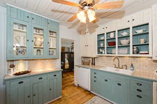 A coating of Annie Sloan Duck Egg Blue Chalk Paint on the cabinets and the entire space was redefined.